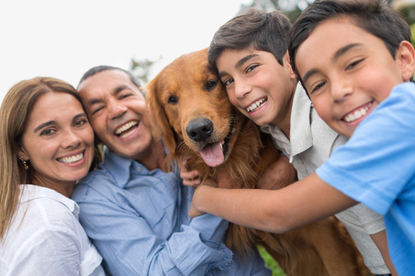 Family of four with dog