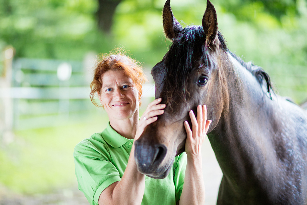 Veterinarian smiling with horse