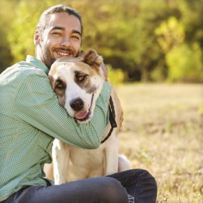 Man hugging a dog