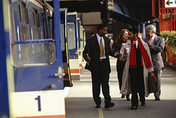 Business people walking on train platform