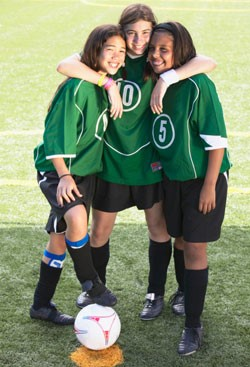 Three girl soccer players