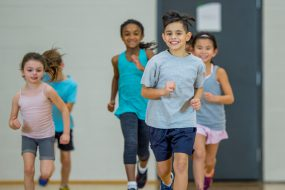 Students running in PE class