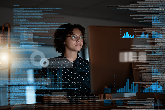 Woman looking at data and statistics on big screen computer