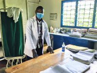 A clinician at a healthcare facility in Kisumu County, Kenya