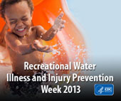 Recreational Water Illness and Injury Prevention Week (RWIIPW) 2013. A small child going down a water slide into the water.