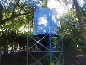 picture of a cistern that resembles a large tank on a stand