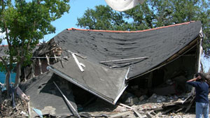 Image of a destroyed home after a hurricane