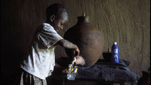 Image of a girl pouring water into a glass from a clay pot