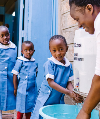 Image of young girls having access to  outdoor handwashing facilities