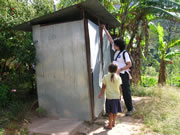 A specialist checking the latrine in a community
