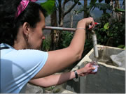 A specialist checking the tap water in a community system