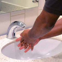 hands under a faucet in a corporate restroom