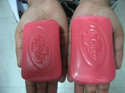 Two bars of soap that are outwardly similar - the original, and a copy with an embedded motion sensor.