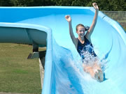 Photo of a girl going down a waterslide