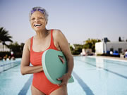 Photo of a senior woman standing by the pool