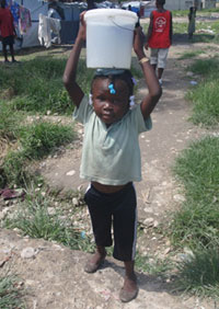 Photo: Child with water bucket on head