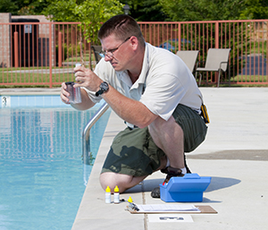 checking the chemicals at a public pool