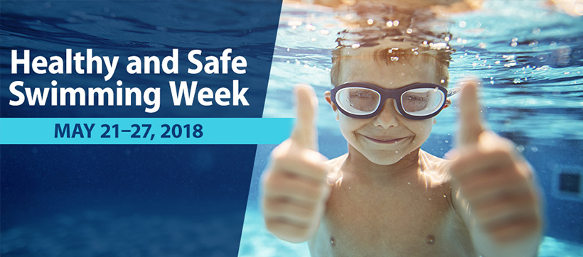 Healthy and Safe Swimming Week is May 21-27, 2018. Image of a little boy underwater in a swimming pool giving two thumbs up