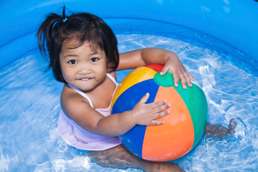 Cute two year old Filipino girl in the water