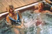 An older couple relaxing in a hot tub