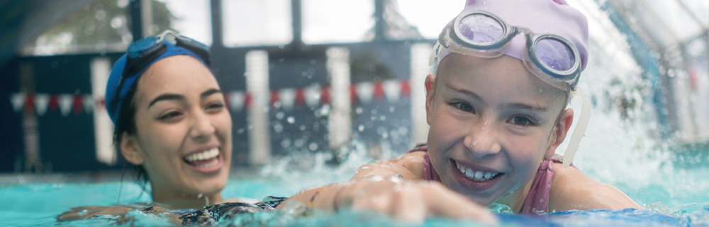 Image of a girl with a female swimming instructor
