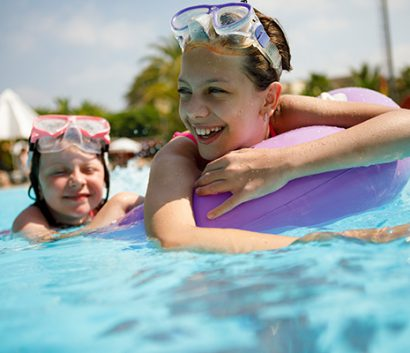 Image of two girls swimming in pool