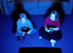 photo of two children playing a video game