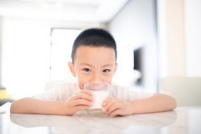 Asian boy drinking milk