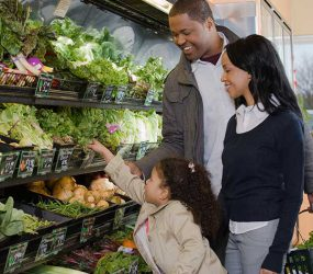 Photo:  A family shopping for fruits and vegetables