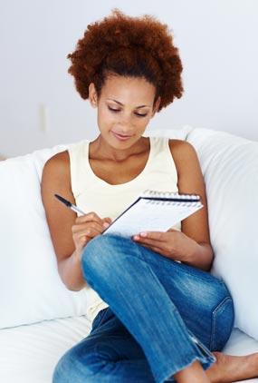 Photo: A woman making a list.