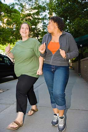 Image of two women walking