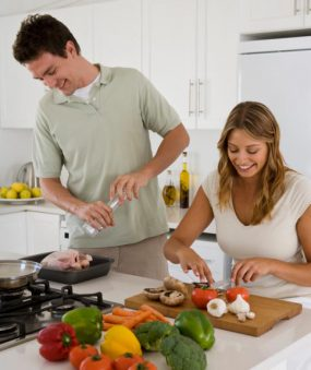 Photo: Couple cooking
