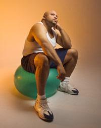 photo of a man thinking, sitting on a gymnastics ball