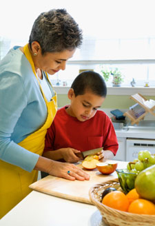 A woman and a boy cooking