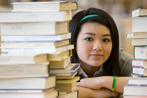 young Asian femal with books
