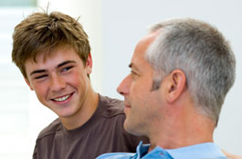 causasian teen talking to father
