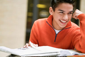 young Latino male studying