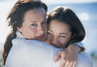 Latina mother and daughter hugging