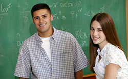Teens in front of chalkboard