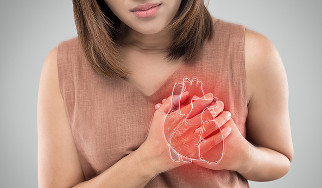 A women holding her hands over her heart.
