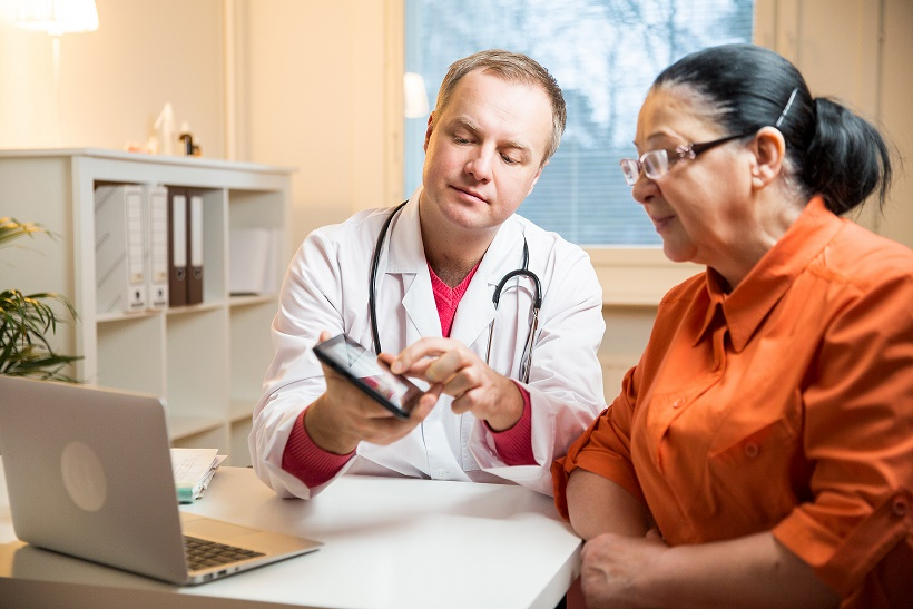 A physician in a medical consultation with a patient.