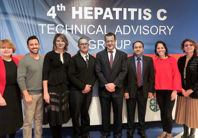 Eight people in front of banner which reads, '4th Hepatitis C Technical Advisory Group'