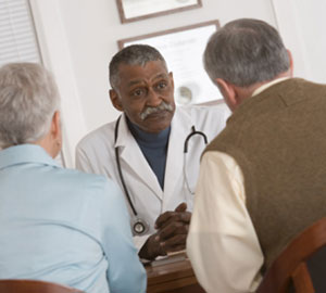 Image of a doctor speaking with patients