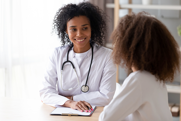 African-American doctor consulting with another African-American woman