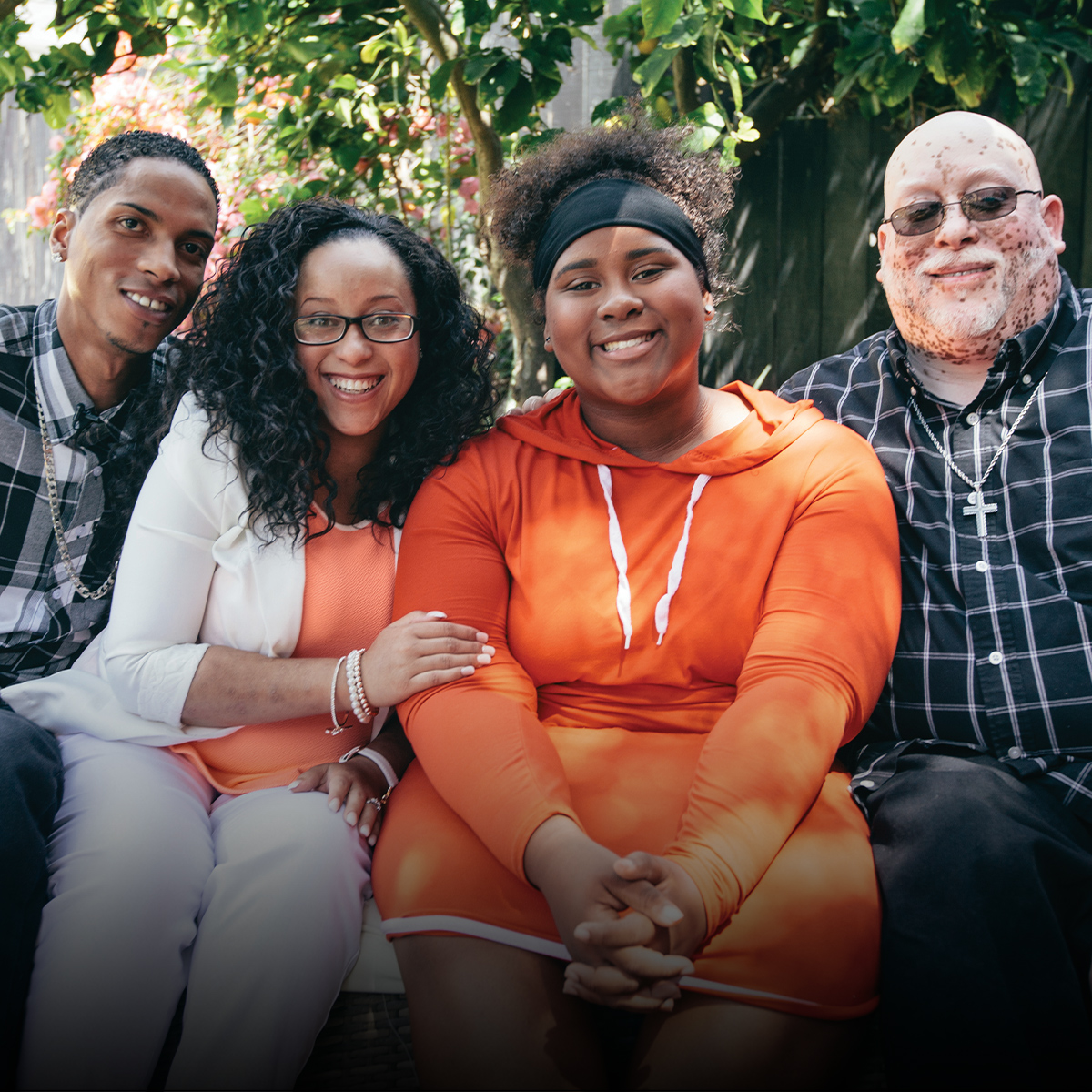 African American family smiling in casual clothing.