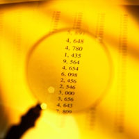 image of a magnifying glass and some numbers