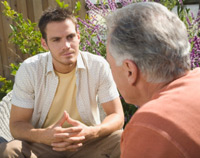photograph of two men in a yard