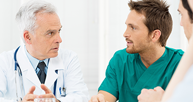 photo of a doctor talking to a man