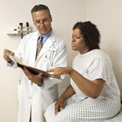 image of a doctor speaking to a female patient
