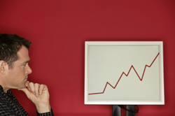 image of a man looking at a linegraph